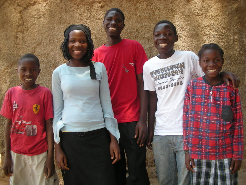 Siblings Zacarias, Silas, Ramos, Felex, and Ronilda in the orphanage in 2009. Today Silas is a hair dresser, Ramos is a chef, and Felex is studying music in Brazil.
